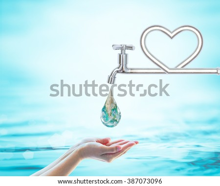 Green world droplet fall on woman human hand from heart love shape pipe water tap faucet on blur blue sea ocean day background: Saving aqua conceptual csr idea: Element of this image furnished by NASA - stock photo