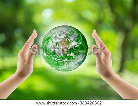 green world in the hand, Globe in the hand, Elements of this image furnished by NASA - stock photo