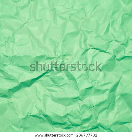 Green wrinkled paper, used as background texture - stock photo
