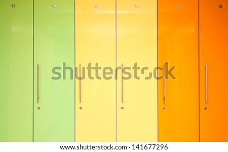 Green Yellow and Orange Lockers in locker room - stock photo