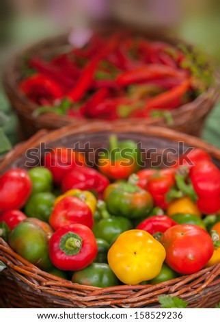 Green,yellow and red cherry paprika in a basket  - stock photo