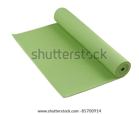 green yoga mat nice for exercise at home or gym - stock photo