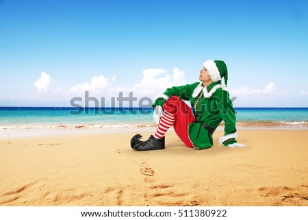 Green young elf and beach of summer time