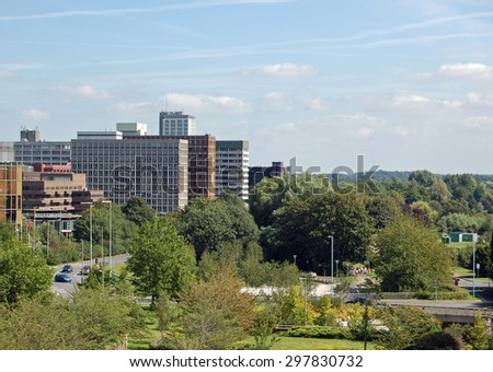Greenery, traffic  and office blocks in the centre of Basingstoke, Hampshire.  A sunny day in August 2007 - stock photo