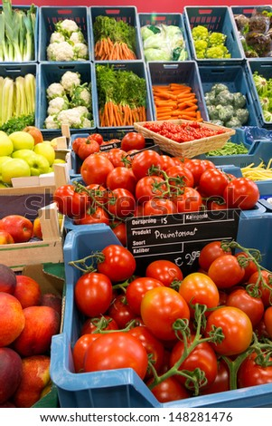 Greengrocer display with fresh vegetables in Europe, with price tages in euros and no brand names - stock photo