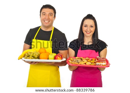 Greengrocer man and confectioner woman showing their fresh products in a market place isolated on white background
