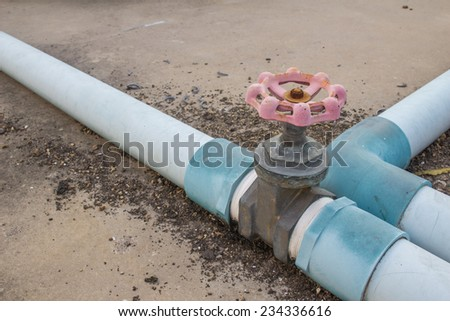 greenish copper metal valve in a beer brewery - stock photo