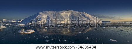 Greenland. A panoramic picture of an iceberg on a decline. - stock photo
