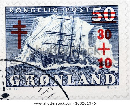 GREENLAND - CIRCA 1950: A stamp printed by DENMARK shows The Arctic Vessel Gustav Holm against iceberg, circa 1950 - stock photo