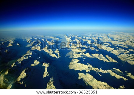 greenland sky and mountains aerial view - stock photo