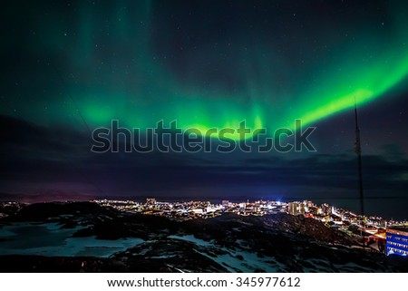 Greenlanic Northern lights, nearby Nuuk, Greenland - stock photo