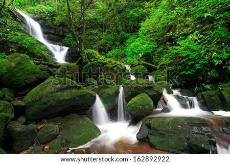 Greenness waterfall of Phu soi dao, Uttaradit, Thailand. - stock photo