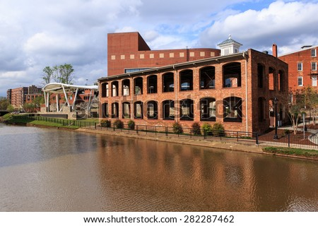 GREENVILLE, SC - MARCH 30, 2015:  Once an old paint factory, this historic building now hosts open air events in downtown Greenville on the Reedy River.