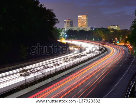 Greenville, South Carolina skyline above the flow of traffic on Interstate 385. - stock photo