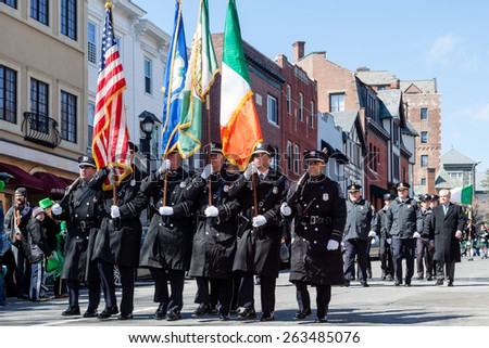 """Greenwich, CT, USA - March 22, 2015: The individuas are some of the many participants in the  """"Annual St. Patrick's Day"""" parade held on March 22nd, 2015, in downtown Greenwich Connecticut.  - stock photo"""