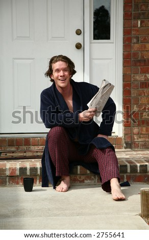 Greeting at the front door by thirty something man with his coffee and newspaper. - stock photo