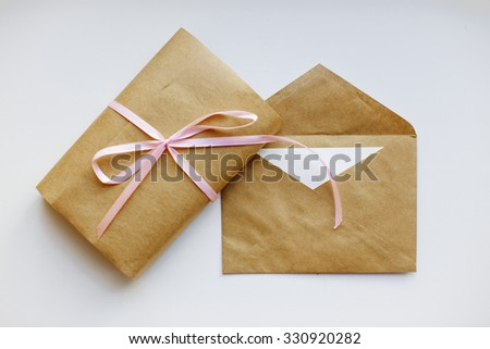 greeting card and gift. wrapped present and an envelope with a greeting card in the same style - stock photo