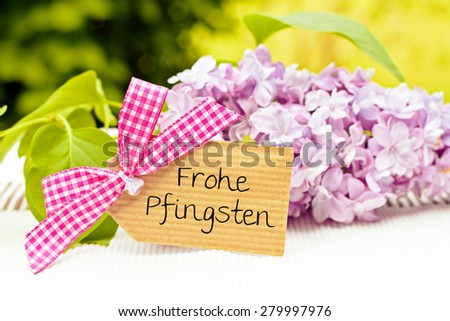 greeting card background for your text - german for happy pentecost - stock photo