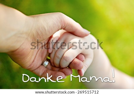greeting card background - hands of mother and child - german for thank you mom - stock photo