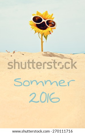 greeting card background - sunflower at beach german for summer 2016 - stock photo