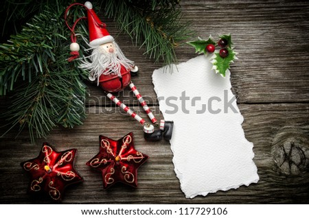 Greeting card for Christmas with Santa Claus decoration and candles - stock photo