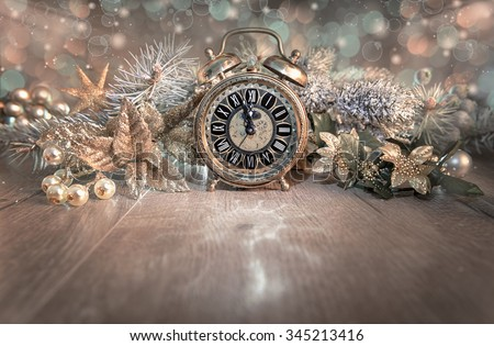 "Greeting card ""Happy New Year 2016!"" with vintage clock showing five to mignight and sparkling decorations. This image is toned. Shallow DOF, focus on the clock - stock photo"