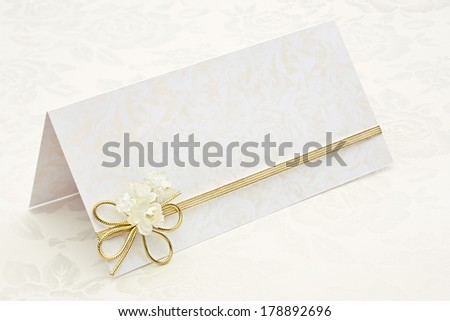 Greeting card with golden stripe and flowers - stock photo