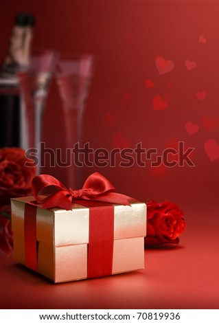greeting card with red roses and gift box