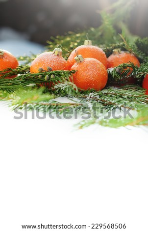 Greeting Card with Tangerines as Fir-tree Toy and Branch of Coniferous on Snow, isolated on white - stock photo