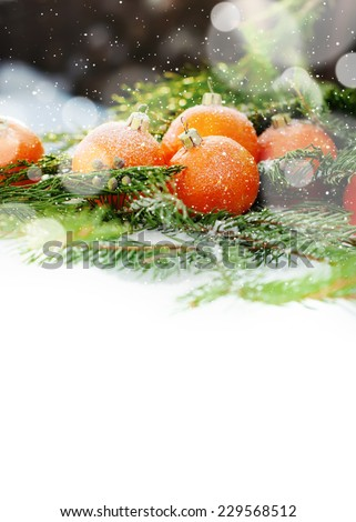 Greeting Card with Tangerines as Fir-tree Toy and Branch of Coniferous on Snow, with boke and snowflakes, isolated on white - stock photo