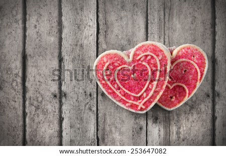 Greeting card with valentine's day cookies on a vintage table - stock photo
