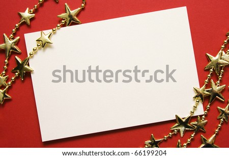 Greeting cards and gold stars on red paper. Natural Textures