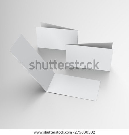 greeting cards or brochures with two wings isolated on grey