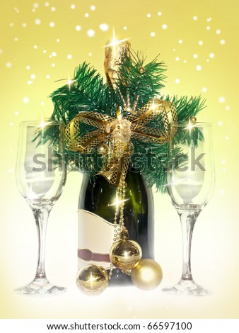 Greeting the New Year. A bottle of champagne, wine glasses and the New Year decorations - stock photo