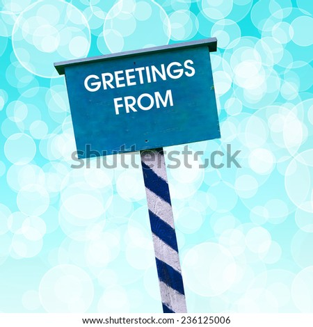 Greetings from card written on blue background with defocused lights - stock photo