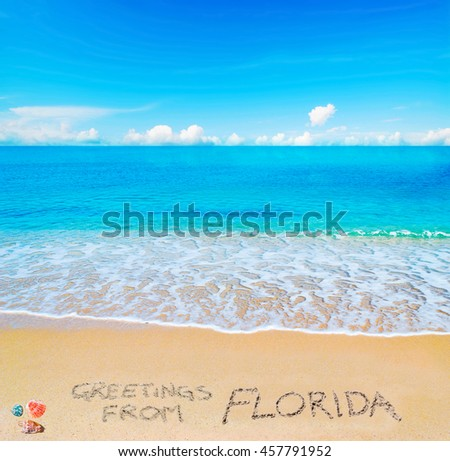 greetings from Florida written on a tropical beach under clouds