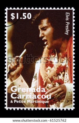 GRENADA - CIRCA 2000: A postage stamp printed in Grenada showing Elvis Presley, circa 2000 - stock photo