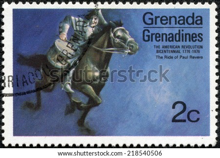 "GRENADINES OF GRENADA - CIRCA 1975: A stamp printed in Grenada from the ""Bicentenary of American Revolution (1976)"" 1st issue shows Paul Revere's ride, circa 1975."