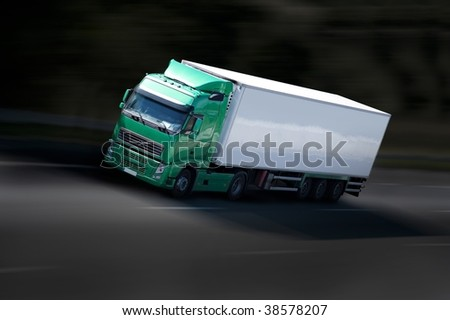 grenn and black semi-truck on highway - stock photo