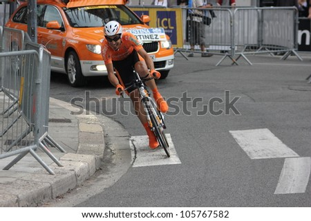 """GRENOBLE, FRANCE - JUN 3: Professional racing cyclist Egoi Martinez rides UCI WORLD TOUR """"CRITERIUM DU DAUPHINE LIBERE"""" time trial on June 3, 2012 in Grenoble, France. Luke Durbridge wins the stage - stock photo"""