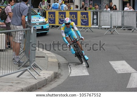 """GRENOBLE, FRANCE - JUN 3: Professional racing cyclist Egor Silin rides UCI WORLD TOUR """"CRITERIUM DU DAUPHINE LIBERE"""" time trial on June 3, 2012 in Grenoble, France. Luke Durbridge wins the stage - stock photo"""