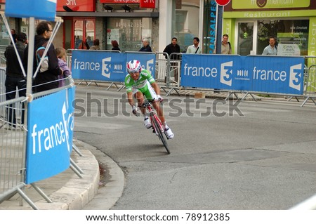 """GRENOBLE, FRANCE - JUN 8: Professional racing cyclist Joaquim Rodríguez rides UCI WORLD TOUR """" CRITERIUM DU DAUPHINE LIBERE"""" third stage time trial on June 8, 2011 in Grenoble city, Isere, France. - stock photo"""