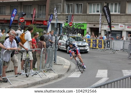 """GRENOBLE, FRANCE - JUN 3: Professional racing cyclist Kenny de Haes rides UCI WORLD TOUR """" CRITERIUM DU DAUPHINE LIBERE"""" time trial on June 3, 2012 in Grenoble, France. Luke Durbridge wins the stage. - stock photo"""