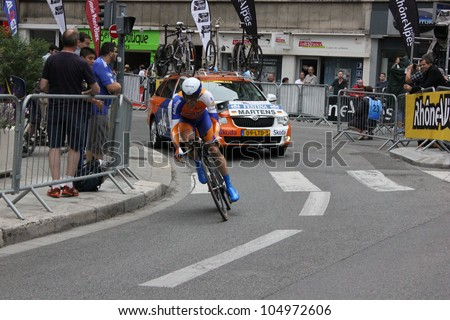 "GRENOBLE, FRANCE - JUN 3: Professional racing cyclist Paul Martens rides UCI WORLD TOUR ""CRITERIUM DU DAUPHINE LIBERE""  time trial on June 3, 2012 in Grenoble, France. Luke Durbridge wins the stage - stock photo"
