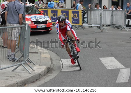 """GRENOBLE, FRANCE - JUN 3: Professional racing cyclist Petr Ignatenko rides UCI WORLD TOUR """"CRITERIUM DU DAUPHINE LIBERE"""" time trial on June 3, 2012 in Grenoble, France. Luke Durbridge wins the stage - stock photo"""