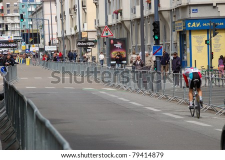 """GRENOBLE, FRANCE - JUN 8: Professional racing cyclist Samuel Sanchez rides UCI WORLD TOUR """" CRITERIUM DU DAUPHINE LIBERE"""" third stage time trial on June 8, 2011 in Grenoble city, Isere, France. - stock photo"""