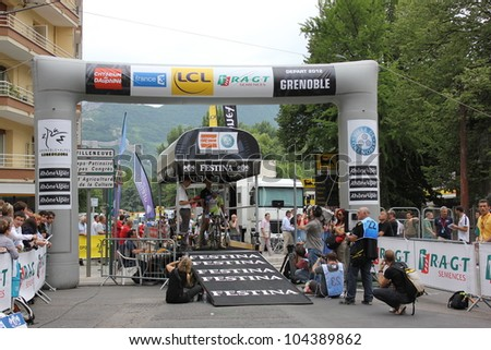 """GRENOBLE, FRANCE - JUN 3: Professional racing cyclist Sarmiento rides UCI WORLD TOUR """"CRITERIUM DU DAUPHINE LIBERE"""" time trial on June 3, 2012 in Grenoble, France. Luke Durbridge wins the stage. - stock photo"""