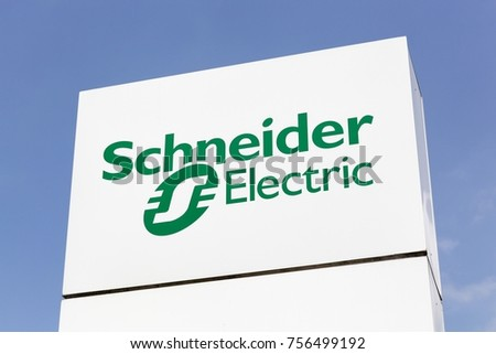 schneider electric logo. grenoble, france - june 24, 2017: schneider electric logo on a panel.