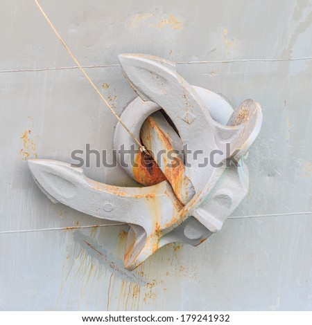 grey anchor on frigate ship - stock photo