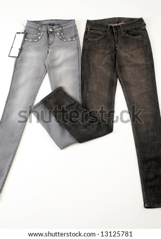 Grey and dark jeans - stock photo